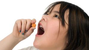 girl-taking-vitamin